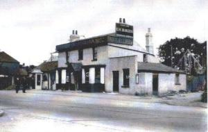 The old Woodman Inn with the new pub being erected behind in 1931