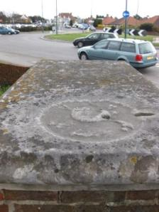 Not much remains of the skull and crossbones on the 'tombstone', 2010