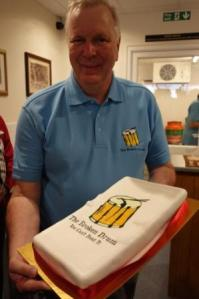 Andy Wheeler with cake to celebrate the grand opening