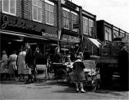 Saturday morning suburban shoppers and lots of prams at Blackfen shopping parade, near Sidcup, Kent, England. Date: early 1960s